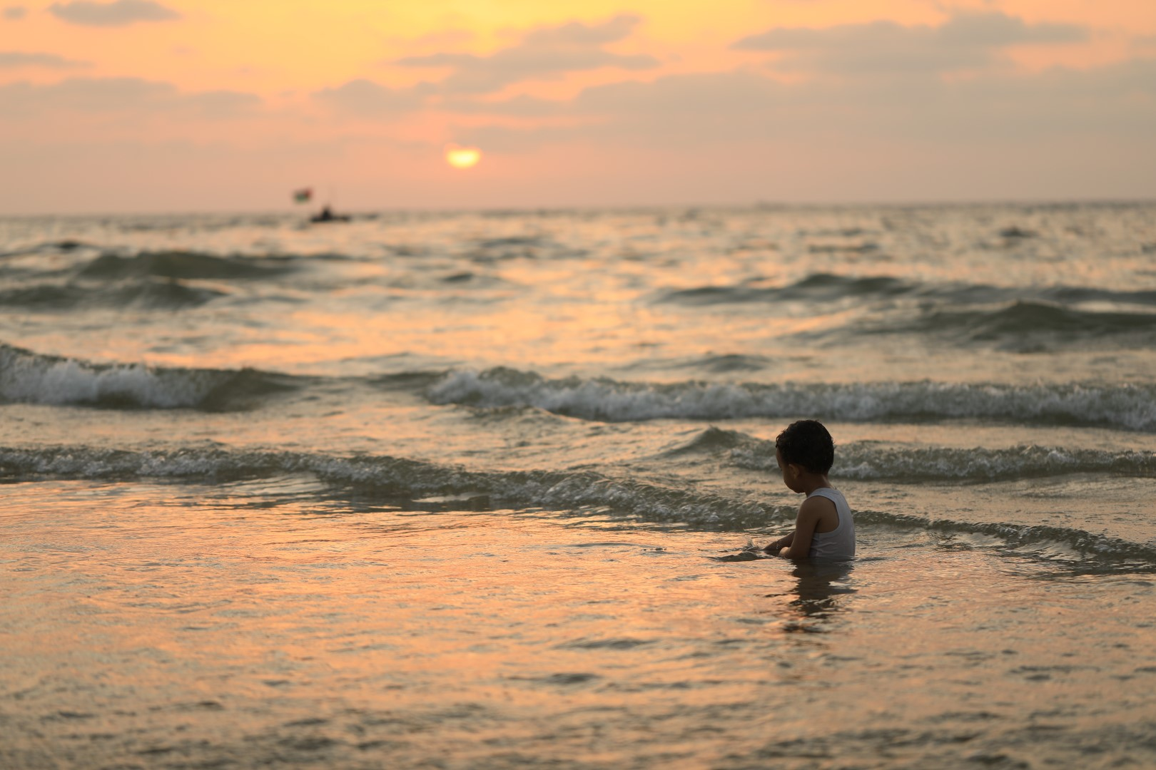 Boy in sea in Gaza